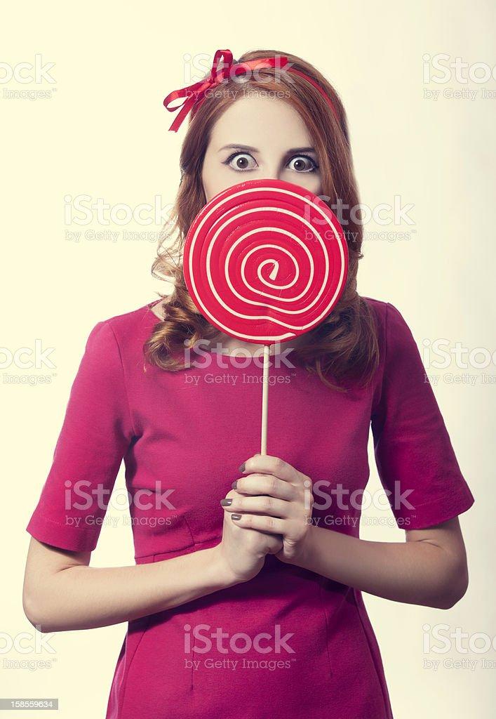 아름다운 빨간 머리 여자아이, 롤리팝. 사진을 레트로 스타일의. royalty-free 스톡 사진