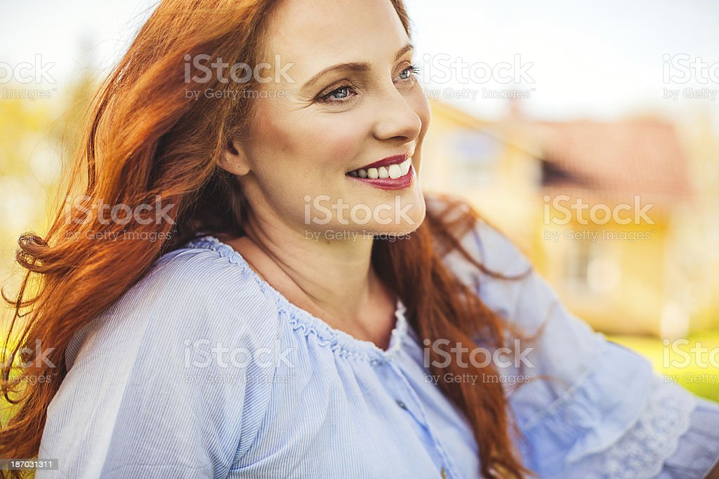 Beautiful redhead outdoors royalty-free stock photo
