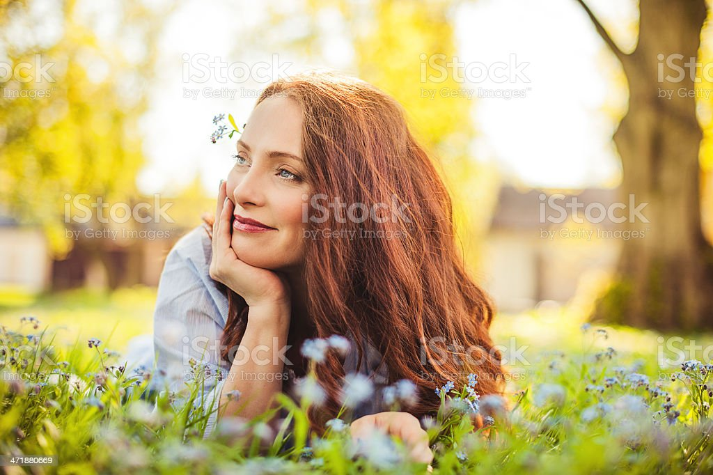 Beautiful redhead outdoors stock photo