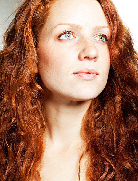 beautiful redhead woman portrait - woman green eyes red hair stock photos and pictures