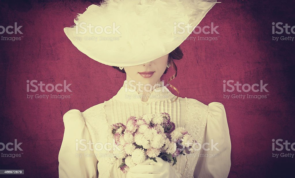 Beautiful redhead women with bouquet stock photo