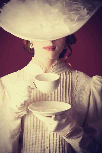 Beautiful redhead women with cup of tea stock photo