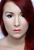 Beautiful redhead young woman with bright make up portrait