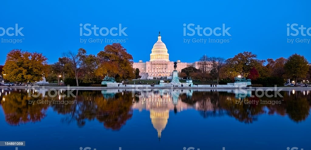 A beautiful reflection of United States Capitol at dawn stock photo