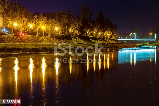istock Beautiful reflection  the river in the city uzgorod Ukraine. 617382928
