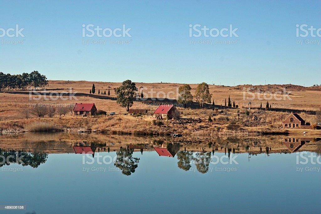 Beautiful reflections on still lake stock photo