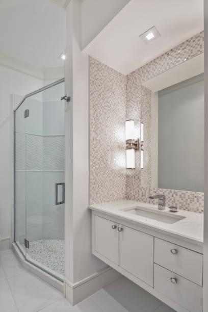 Beautiful remodeled bathroom in a condominium stock photo