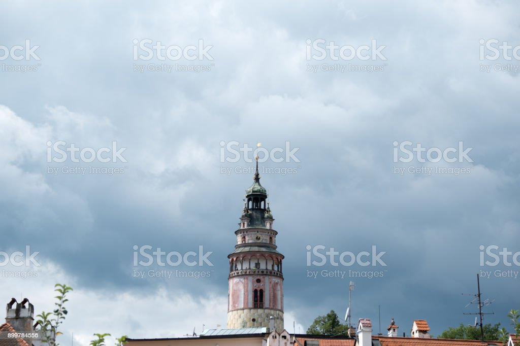 Beautiful Renaissance Castle Tower elaborately decorated with frescos against a stormy sky in charming medieval town of Cesky Krumlov. Castle tower in the centre, room for copy space. Stormy sky. stock photo