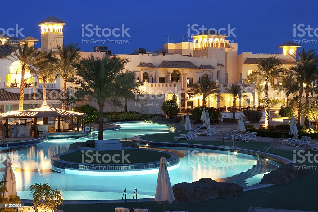 Beautiful Resort Pool on evening. stock photo