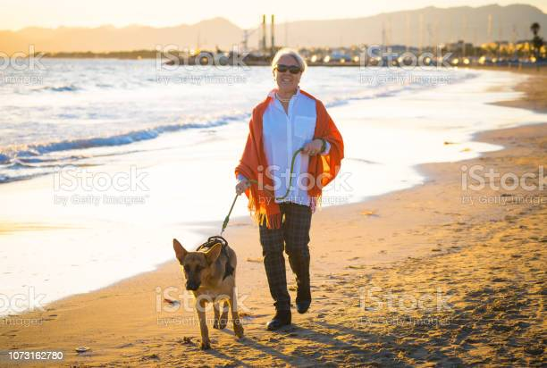 Beautiful retired older woman and pet german shepard dog walking the picture id1073162780?b=1&k=6&m=1073162780&s=612x612&h=uqoiergwp4ike fnwwcm1pzuueacuiewywbjuj69g2w=