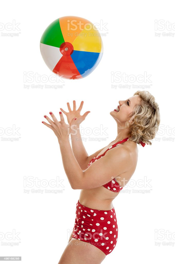 Beautiful Retro Pinup Girl with Beach Ball stock photo