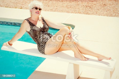 Beautiful retro woman enjoying sun by the pool in a swimming suit. You might also be interested in these: