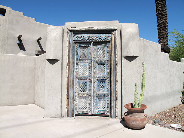 Beautiful revival style wooden doorwar Beautiful revival style wooden door way with stucco wall revival stock pictures, royalty-free photos & images