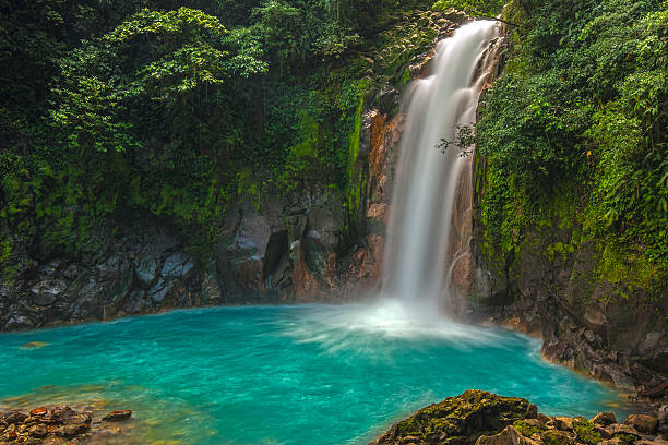 beautiful rio celeste waterfall - waterfall stock photos and pictures