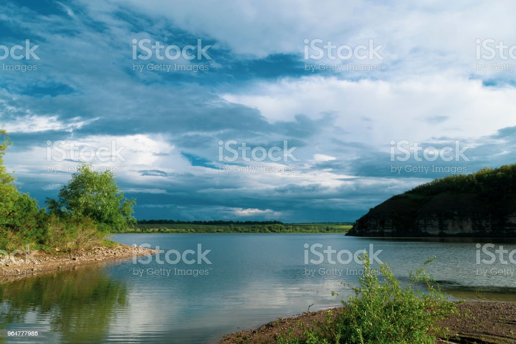 Beautiful river landscape. Calm river with colorful sky reflection on it. River flow on sunset royalty-free stock photo