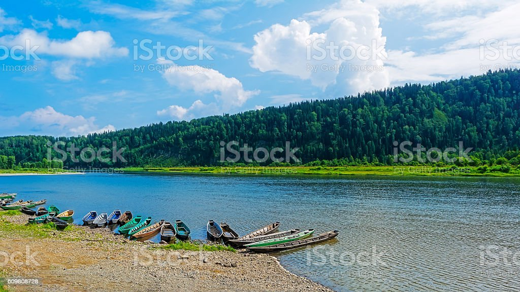 Beautiful river landscape with boats moored to bank of river stock photo