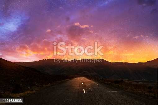Beautiful road and sunset sky with clouds.