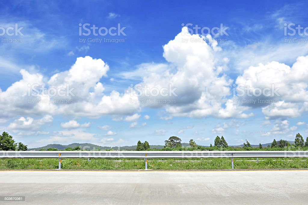 Beautiful roadside view with green hills and blue sky  background stock photo
