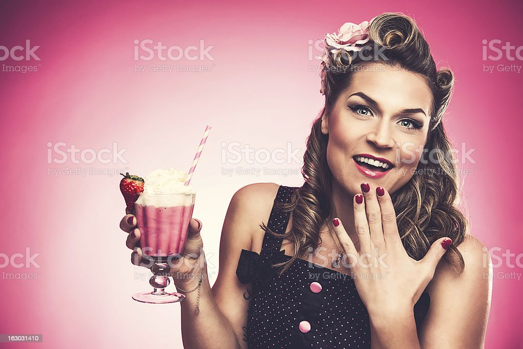 Beautiful rockabilly woman with milkshake stock photo