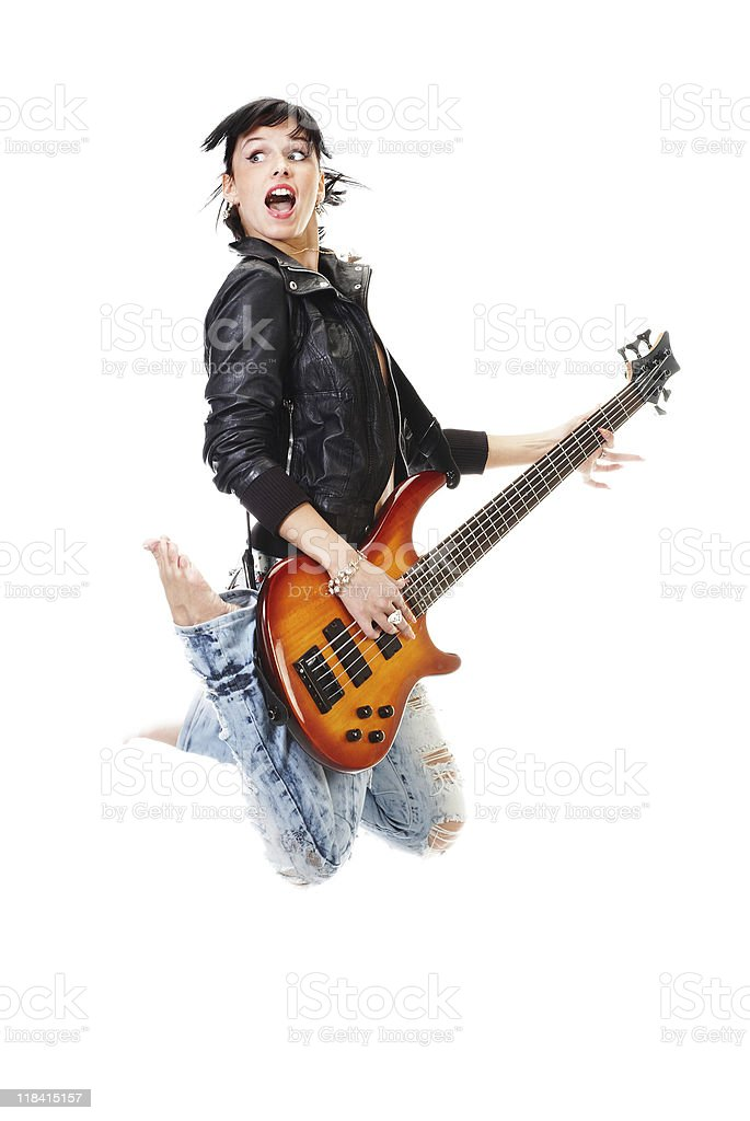 Beautiful rock-n-roll girl jumping with guitar isolated stock photo