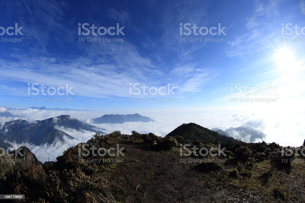 beautiful rolling clouds and snow mountain landscape stock photo