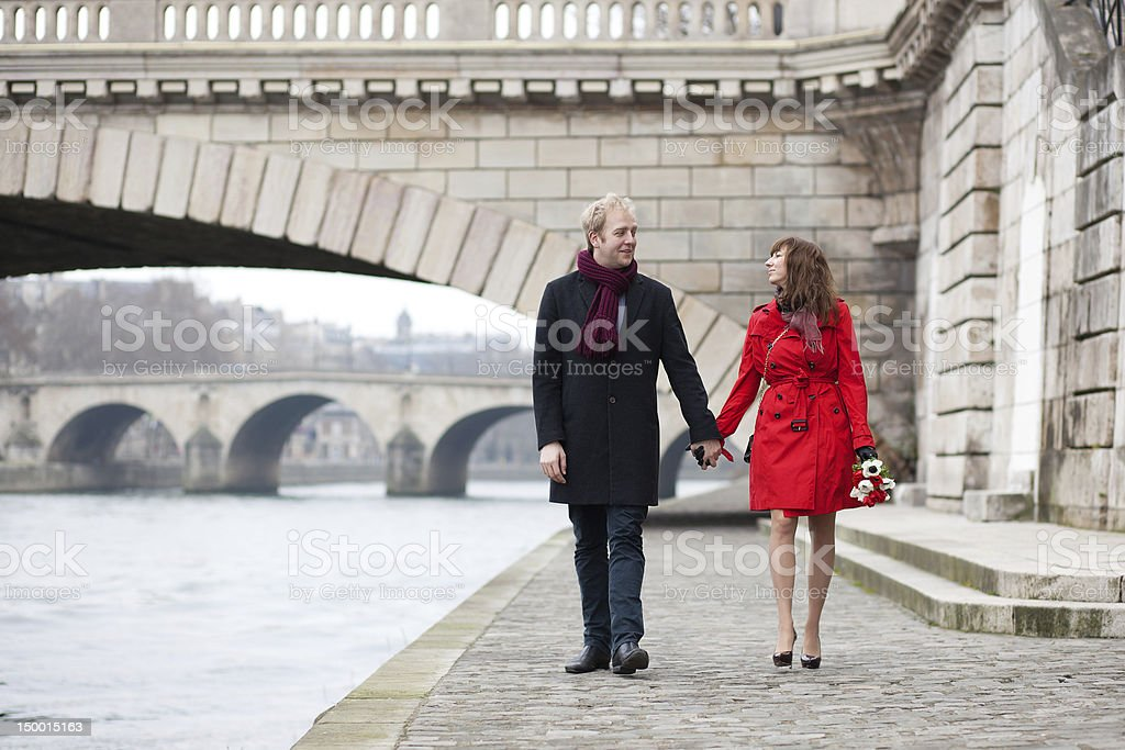 Beautiful romantic couple on a Parisian embankment royalty-free stock photo