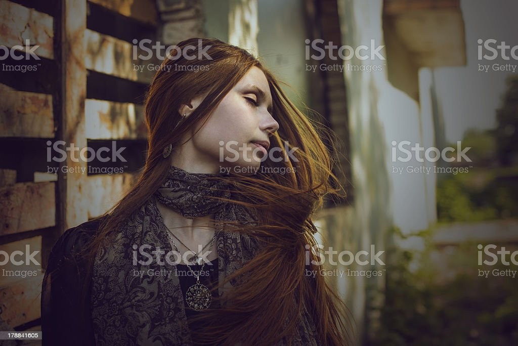 beautiful romantic girl with long hair in the village royalty-free stock photo