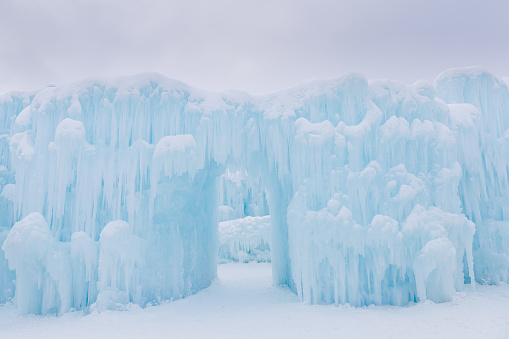 beautiful romantic ice castle with arch entrance way.
