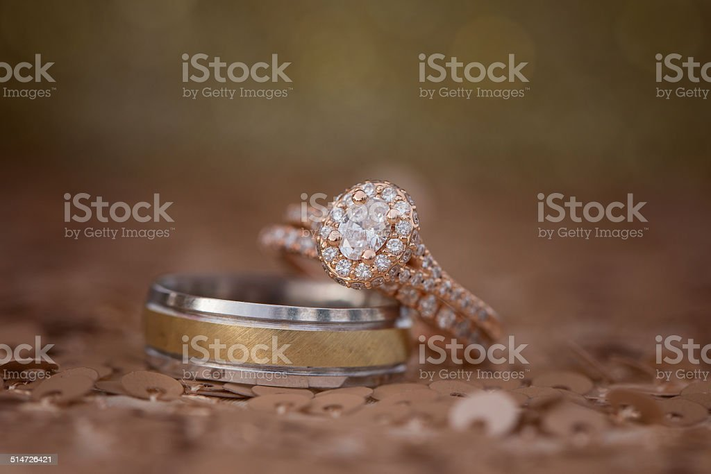 Two gold weddings rings on a sequence background