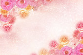 istock beautiful roses flower border with copy space glitter background 1022617622