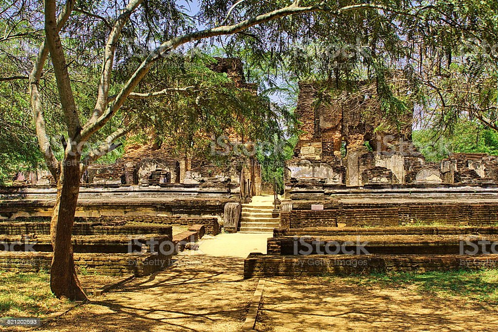 Beautiful ruines of exotic ancient hinduist temple stock photo