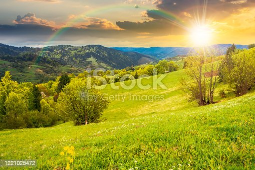 beautiful rural landscape in mountains at sunset. countryside scenery on an overcast weather in spring in evening light