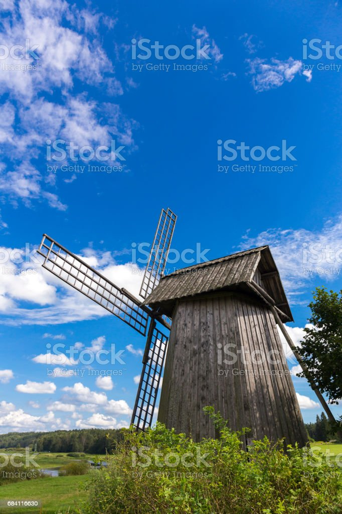 Beautiful rural landscape with old windmill royalty free stockfoto