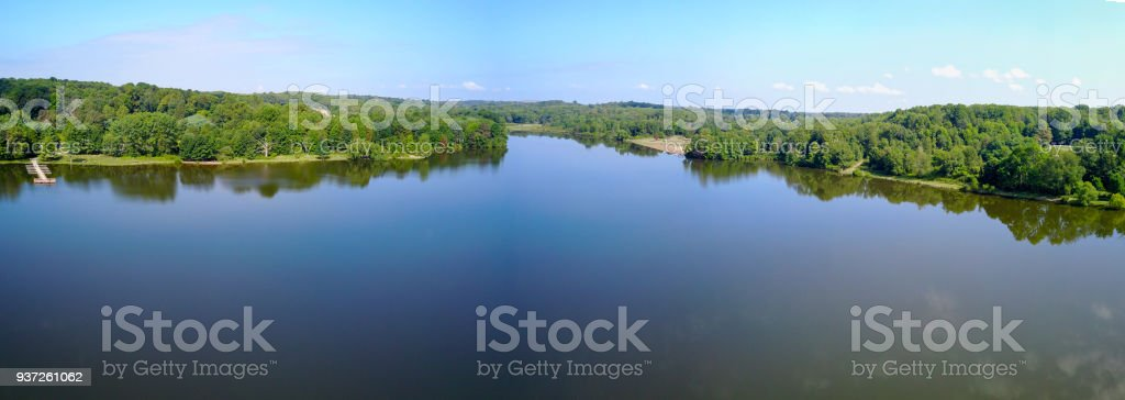Beautiful rural parnorama landscape with lake and dock stock photo