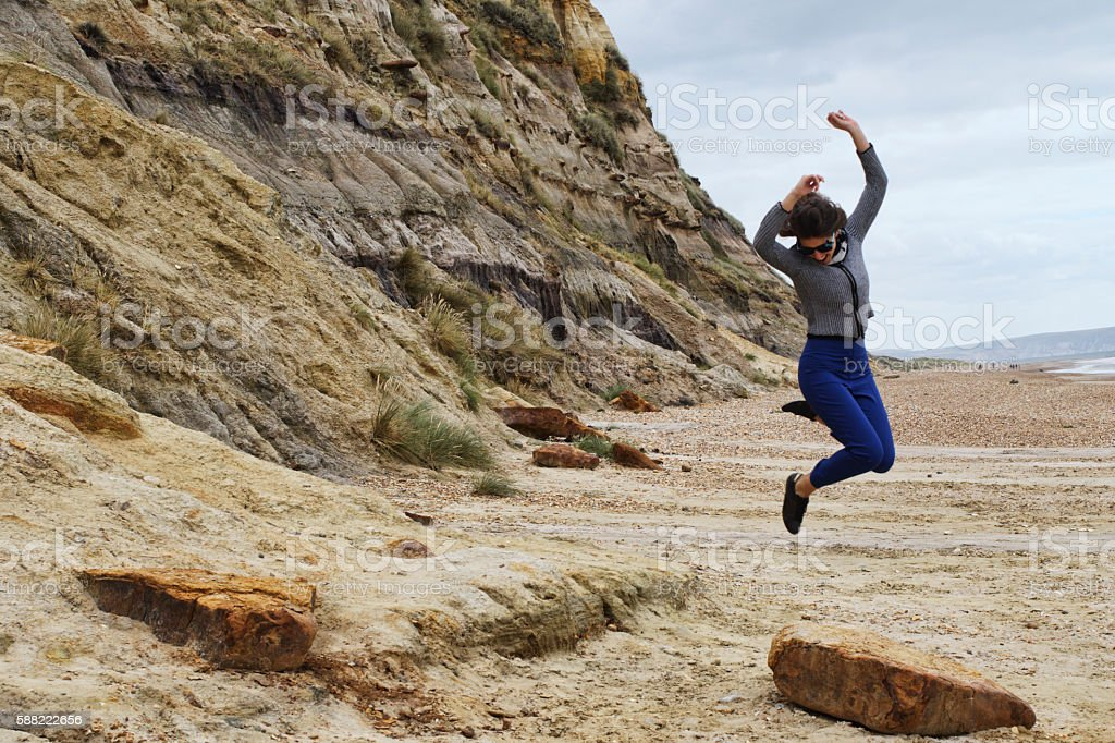Russian outdoor girl leaping in the air Hengistbury Head beach stock photo