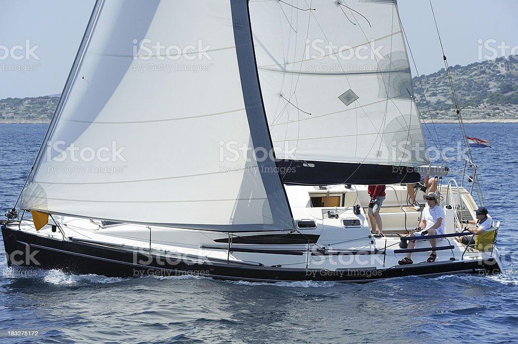 Beautiful sailing boat at full speed royalty-free stock photo