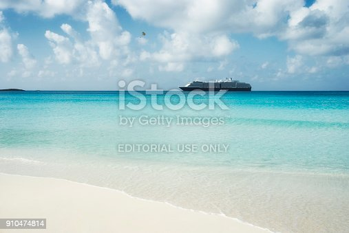 istock Beautiful sand beach with crystal clear water and cruise ship anchored, Bahamas 910474814