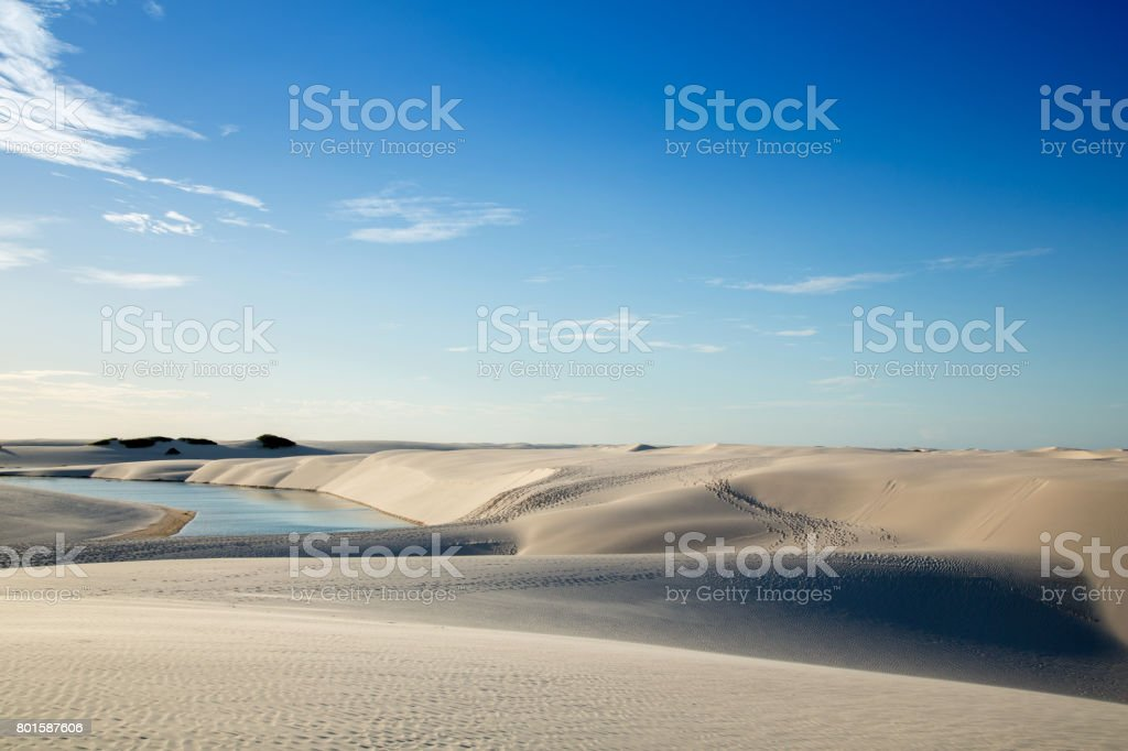 Beautiful sand dunes with a blue lagoon stock photo