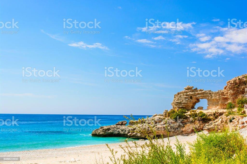 beautiful sandy beach with cliff. ionian sea in Dhermi, Albania stock photo