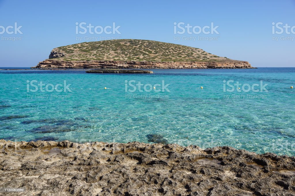 Beautiful sandy Cala Comte beach with azure blue sea water, Ibiza island, Spain - foto stock