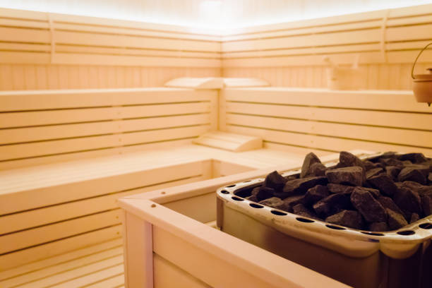 Beautiful sauna interior with stones Beautiful sauna interior with heater  and stones sauna stock pictures, royalty-free photos & images