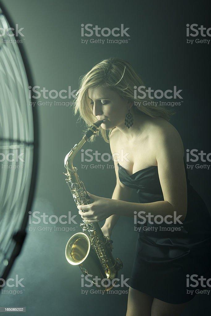 Beautiful saxophonist stock photo