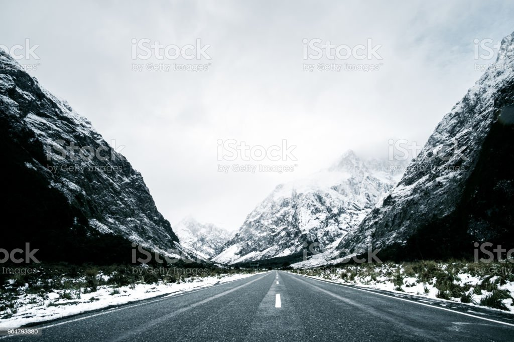 Beautiful scene of empty road to Milford sound after snow. royalty-free stock photo