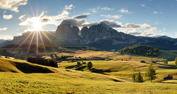 istock Beautiful Scenery from Alpe di Siusi, Italy in summer sunrise light with small wooden cottage and sharp mountains of dolomite. Seiser Alm with Langkofel Group South Tyrol, Italy 912065032