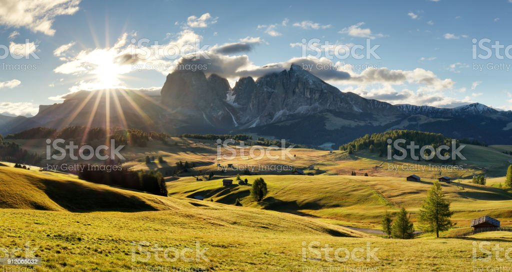 Beautiful Scenery from Alpe di Siusi, Italy in summer sunrise light with small wooden cottage and sharp mountains of dolomite. Seiser Alm with Langkofel Group South Tyrol, Italy stock photo