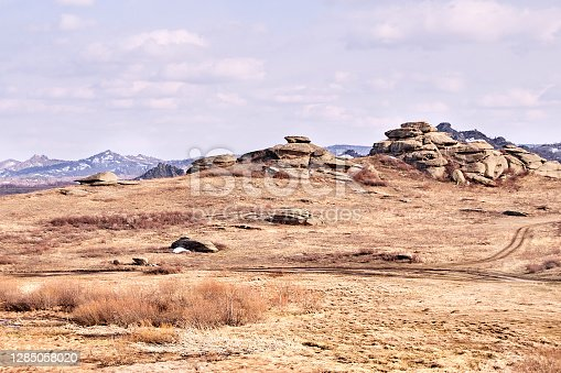 istock Beautiful scenery. Gray stones. Mountain landscape. Dry grass 1285058020