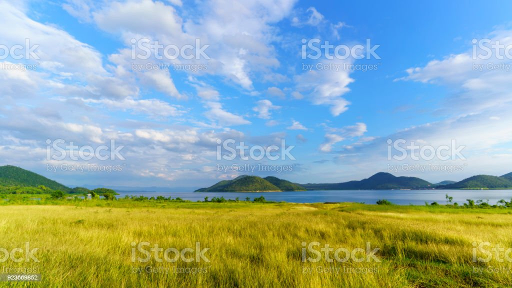 Beautiful scenery of Srinagarind Reservoir or Srinakharin dam with white clouds and blue sky in the  morning , Kanchanaburi , Thailand stock photo