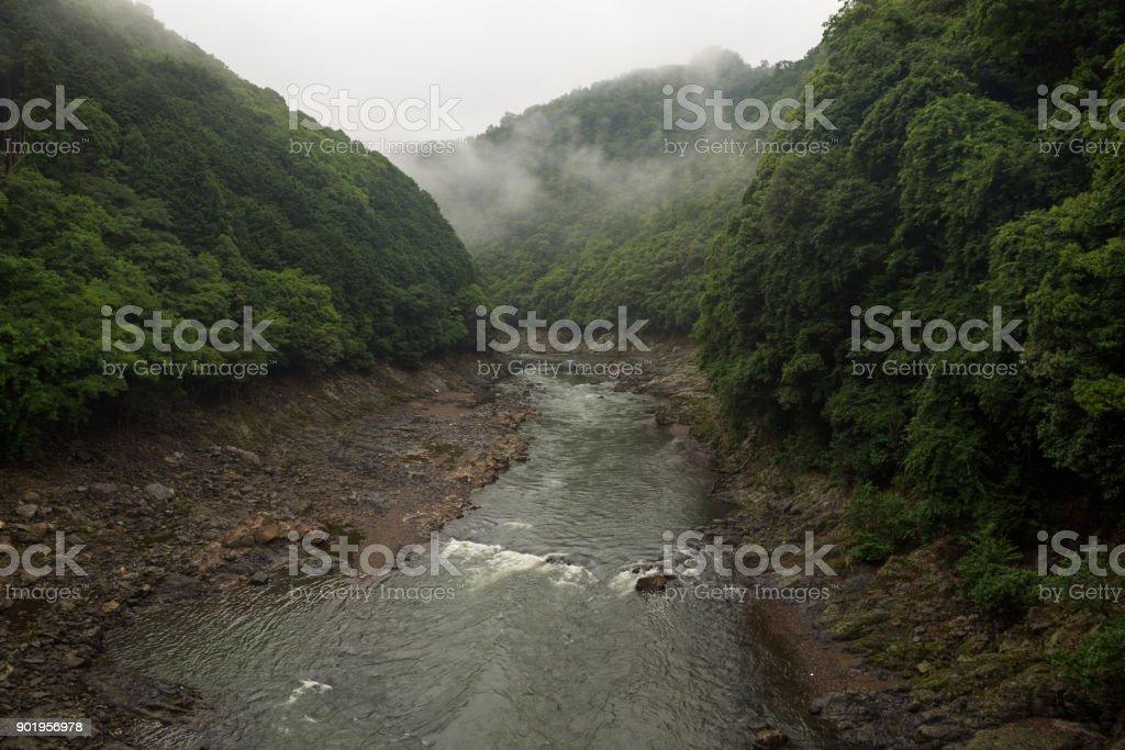 Beautiful scenery of the Katsura river along the tracks of the Sagano Scenic Railway stock photo