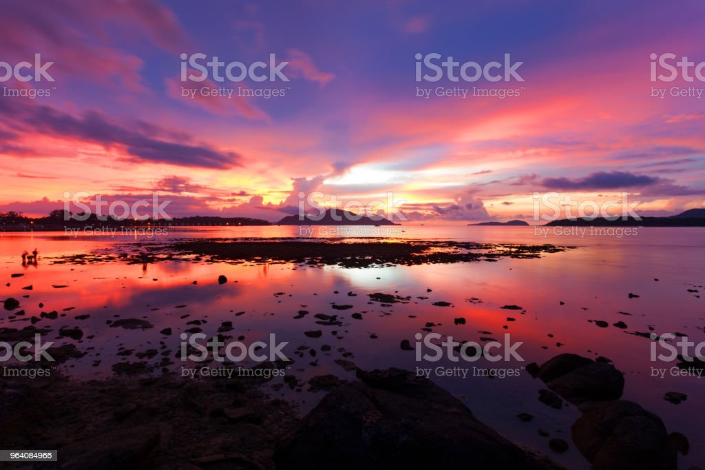 Beautiful scenery sunset or sunrise dramatic sky view of the sea and reflection in water. - Royalty-free Backgrounds Stock Photo
