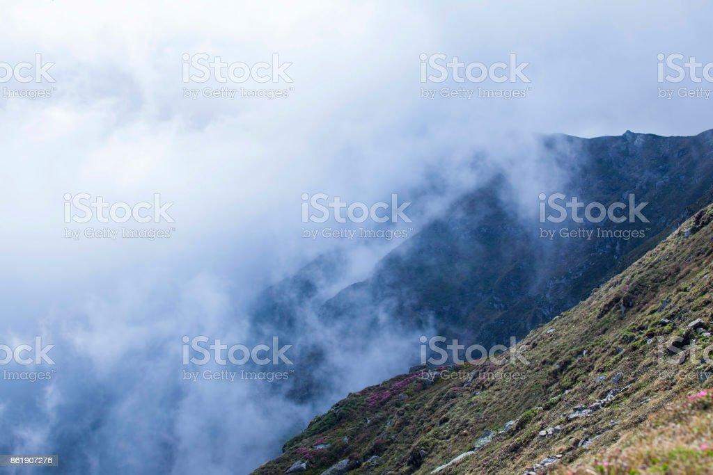 Beautiful scenic foggy mountain landscape , misty mountain peaks stock photo